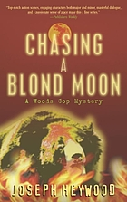 Blue wolf in green fire : a woods cop mystery : a novel