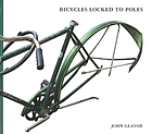 Bicycles locked to poles : photographs