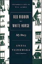 Red ribbon on a white horse