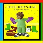 Little Brown Bear plays with shoes