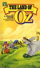 The land of Oz : being an account of the further adventures of the Scarecrow and Tin Woodman and also the strange experiences of the Highly Magnified Woggle-Bug, Jack Pumpkinhead, the Animated Saw-horse and the Gump ; the story being a sequel to The Wizard of Oz