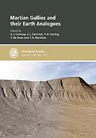 Martian gullies and their Earth analogues
